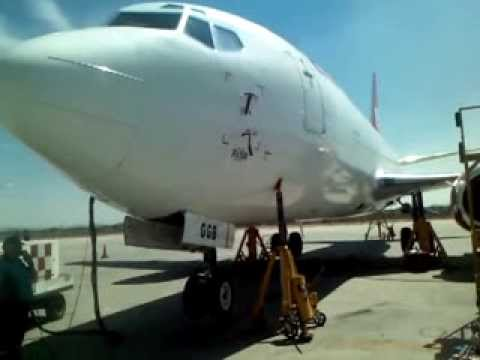 ESTAFETA Boeing 737-300F aircraft on jacks, landing gear extension and retraction test.