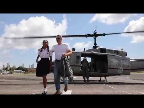 US Ambassador John D. Feeley and Leyda Díaz ride in a helicopter over Panama City, Panama