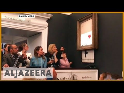 🇬🇧 Banksy painting self-destructs after $1.4 million sale   Al Jazeera English