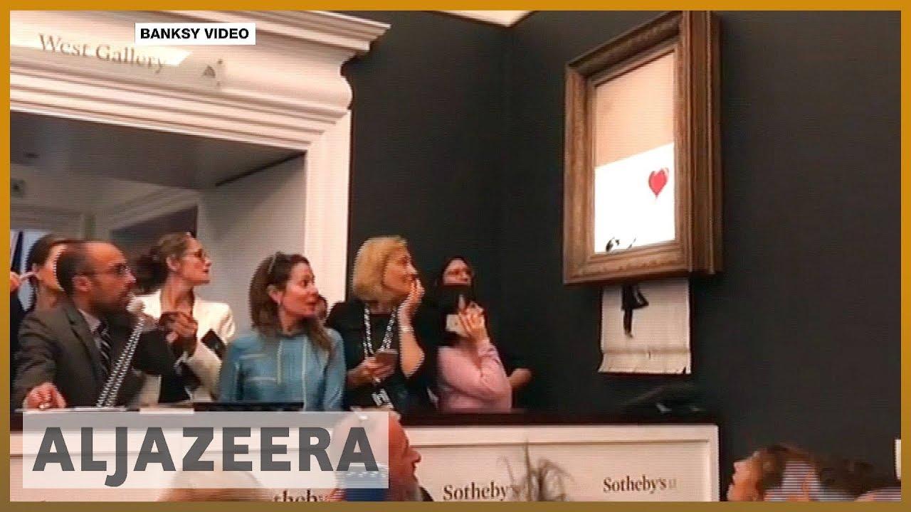 🇬🇧 Banksy painting self-destructs after $1 4 million sale   Al Jazeera  English