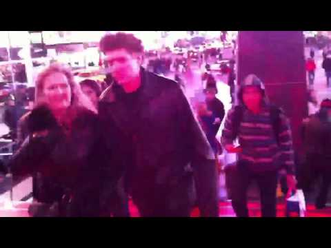 Walking down red light steps in time sqaure, New york city