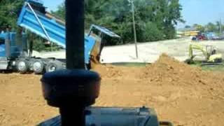 Quad Axle Kenworth Dumping  Dirt