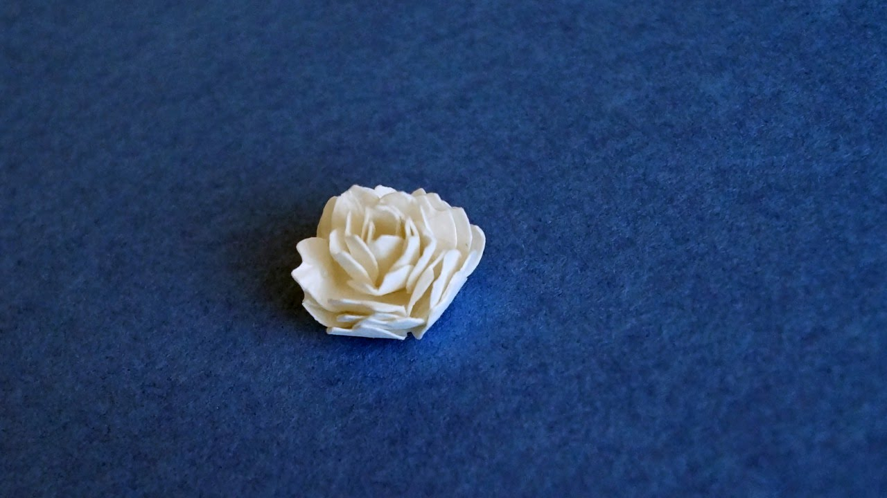 Make a beautiful tiny paper flower diy crafts guidecentral youtube make a beautiful tiny paper flower diy crafts guidecentral mightylinksfo
