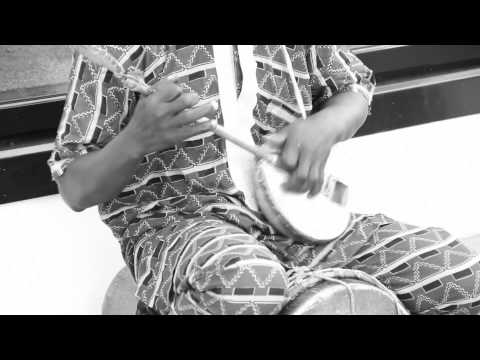 African Music - An african man with talent  singing in the street