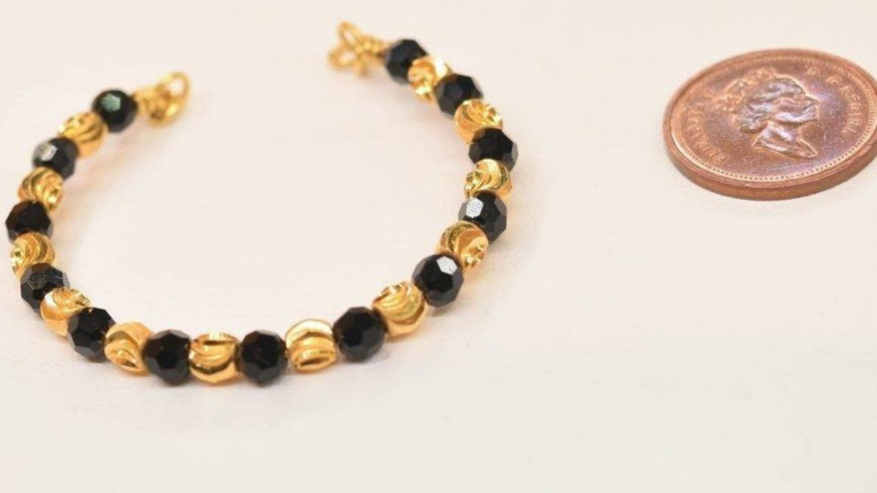 gold bracelet pyramid black