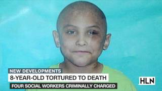 Social workers charged with child abuse in torture death of boy
