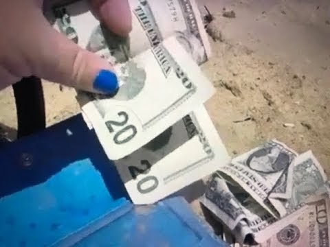 PILE OF REAL MONEY FOUND AT BEACH WHILE METAL DETECTING