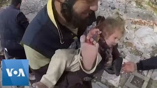 Syria Civil Defense: Children and Baby Pulled From Rubble After Air Strikes on Syrian Village