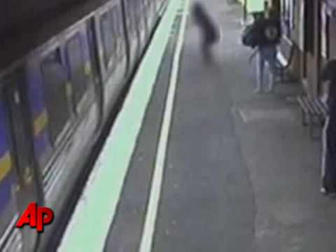 stroller-with-baby-falls-underneath-moving-train