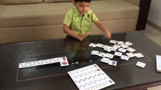 Moksh Busy With Cursive Patterns: A Pre-writing Activity 1/6
