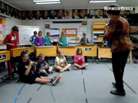Cottonwood Plains Elementary School music teacher Olivia Tremblay gives lessons to fifth-graders Wed