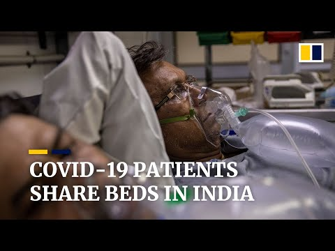 One bed, two patients: India's hospitals overwhelmed by rising Covid-19 infections