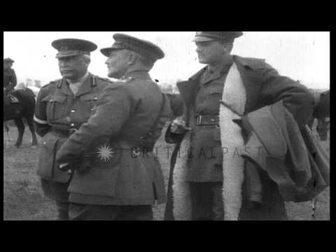 British General George Milne, and General Sir Bryan Mahon watch a chariot race in...HD Stock Footage