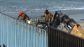 US workers reinforce border wall on Tijuana beach