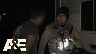 Officers intervene after a man pulls a gun on his roommate due to a...