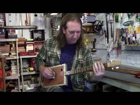 Whats the Difference Between a 3 String and 4 String Cigar Box Guitar?