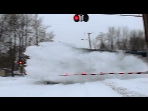 80MPH Amtrak trains plowing snow