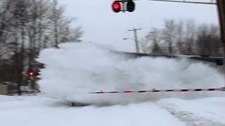 80MPH Amtrak trains plowing snow