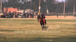 Sikh warriors ride horses in slow motion