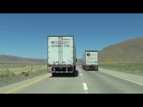 A semi truck passing me on Interstate 80 in Nevada..