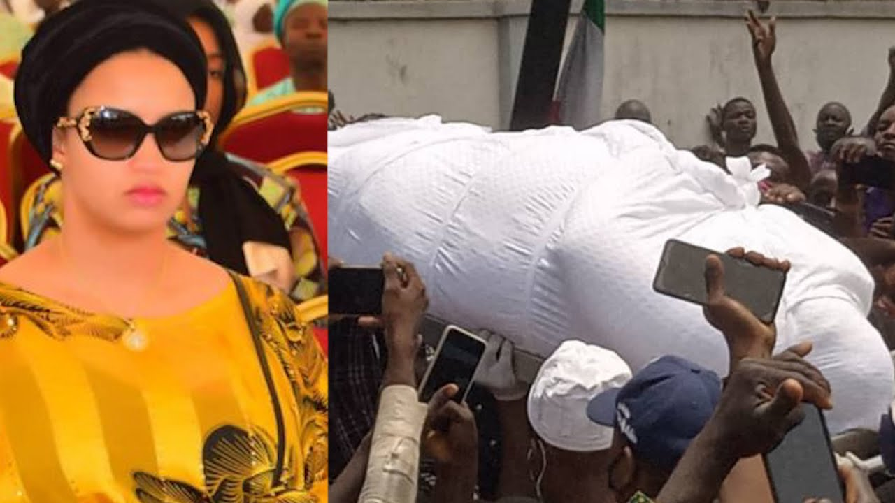 BURUJI KASHAMU'S WIFE BREAKS DOWN IN TEARS AS SHE SEES HER HUSBAND CORPSE