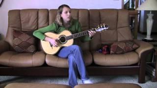 Macyn Taylor picks up her new Petros baroque parlor guitar on Novem...