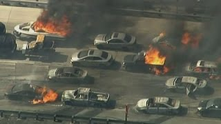 Raw: Wildfire Sweeps Over CA Freeway, Burns Cars