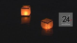Нижнекамцы пустили по Каме сотни огненных фонариков
