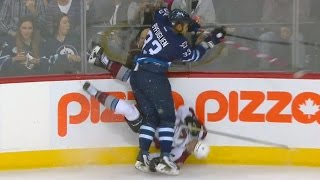 Byfuglien flattens Barrie with monster check