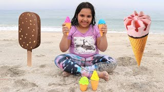 children buy ice cream on the beach