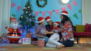 Cute Christian family happily enjoying while celebrating Christmas in India
