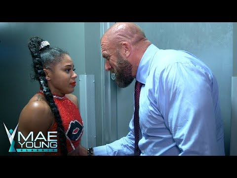 Triple H comforts Bianca Belair after her...