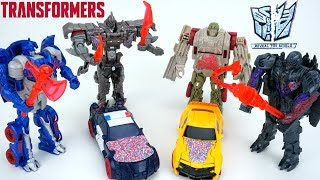 Transformers the Last Knight Reveal the Shield One Step Turbo Changers Barricade Optimus Megatron