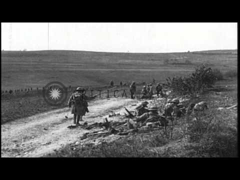 US 35th and 58th Infantry troops advance under heavy fire and in prone position b...HD Stock Footage