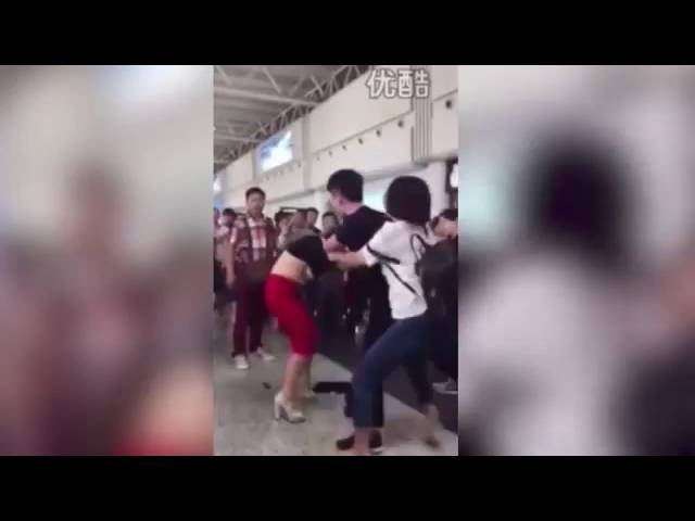 Angry Wife Beats And Strips Husband's Mistress In Airport