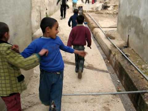 Children singing in the Gaza Palestinian Refugee Camp (Jerash, Jordan)