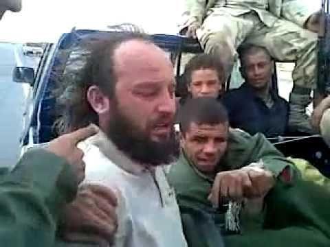Gaddafi Soldiers Abusing Prisoners (ENGLISH SUBTITLES)