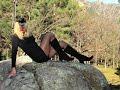 Sexy Crossdresser in Pantyhose & Stockings outdoor scene in the park.