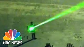 Authorities Warn Of Dangers Of Pointing Lasers At Aircraft | NBC Nightly News
