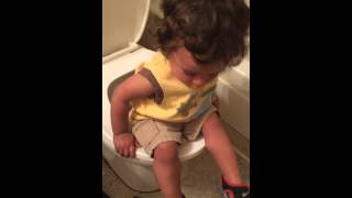 He wanted to sit on the toilet (potty training)  big fail.....