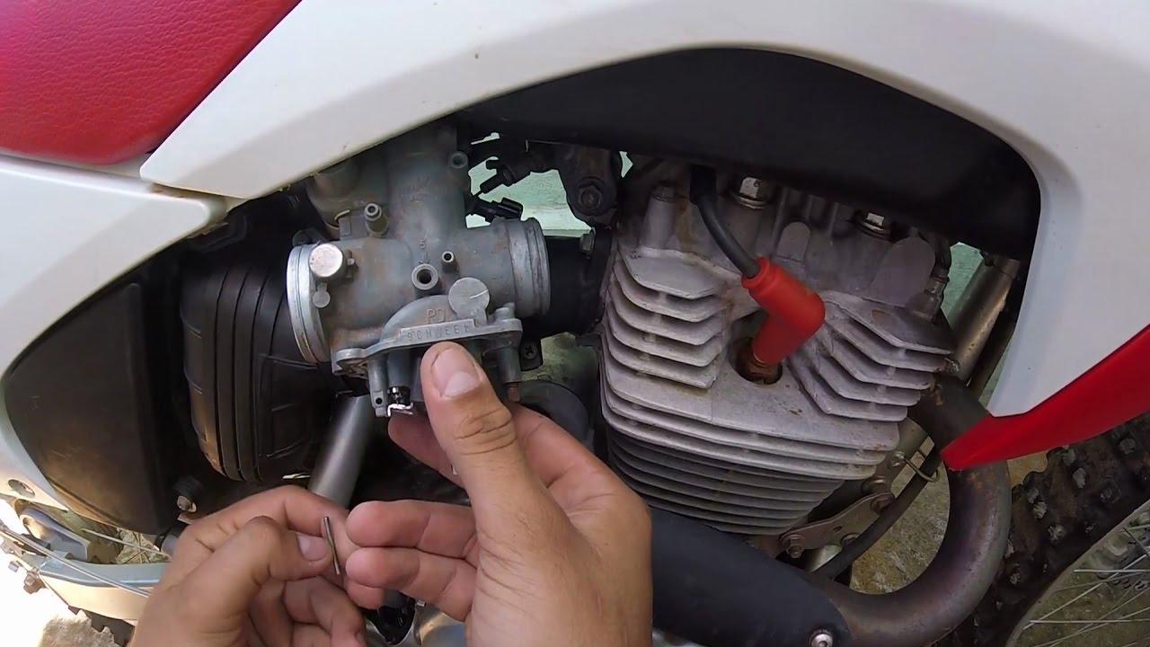 Como regular a boia do carburador da CRF 230 para não afogar no grau