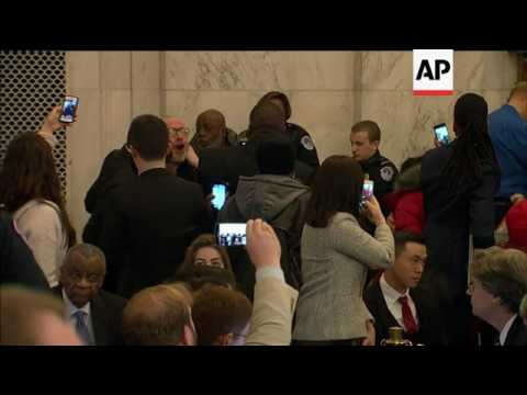 Protesters disrupt US attorney-general hearing