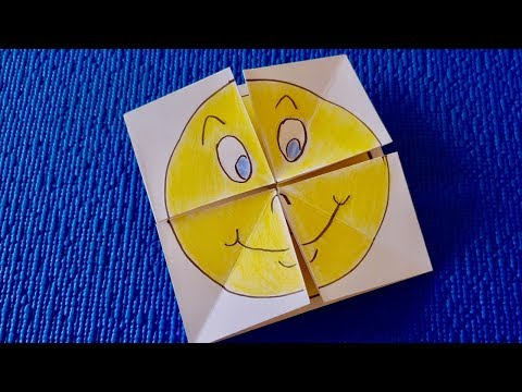 Origami of paper smiles changing a face. Origami toys made of paper