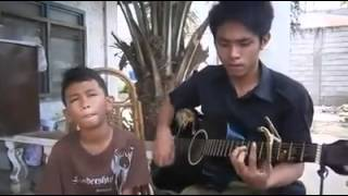 Filipino boy sings Dance With My Father. please share.