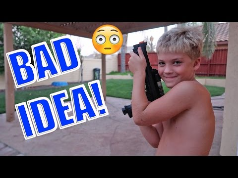 KID PLAYING WITH PAINTBALL GUN!