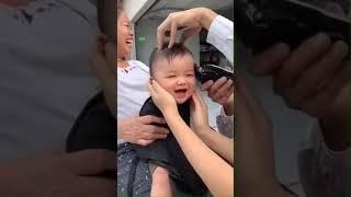 Baby smile while hair cut