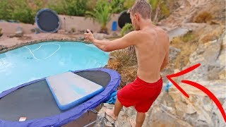 CATAPULTING TRAMPOLINE SLIP N SLIDE INTO POOL!