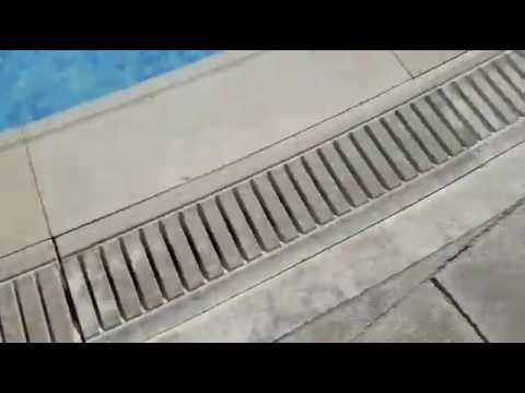 Fantastic Pool Decor With Overflow Drainage Grates From Beige Marble Copings