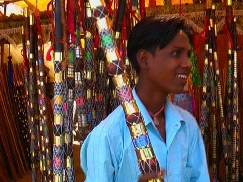 Shopping of decorated bamboo sticks, Pushkar
