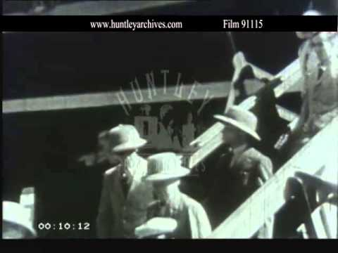 Men in pith helmets disembark from ship at Bombay in India.  Film 91115